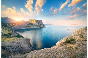 Beautiful scene with mountains, blue sea, high rocks