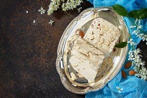Halva with almond petals.