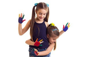 Little girls with colored hands