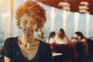 Portrait of ebony girl in cafe