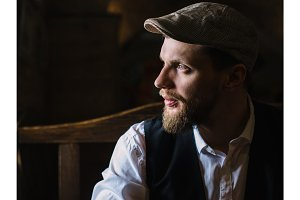 Young bearded man in a pub, vintage style