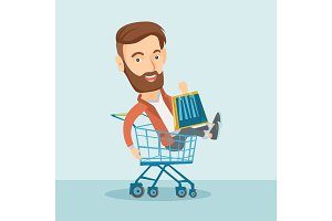 Happy man riding in shopping trolley.