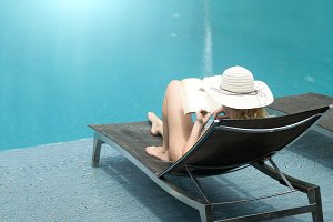 woman with hat summer swimming pool