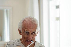 Senior man brushing his teeth