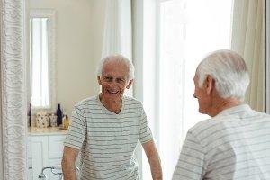 Senior man looking at mirror
