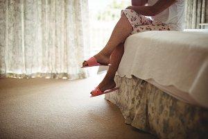 Senior woman sitting on bed