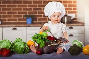 Baby girl dressed in cook toque