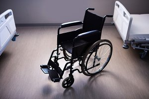 Empty wheelchair in ward