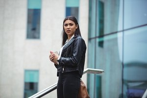 Woman standing outside the office building