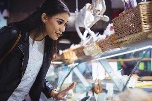 Woman looking at food display