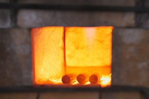 Forging a fire for heating metal in forge oven