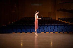 Female business executive practicing speech