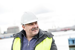 Senior engineer builder at the construction site.