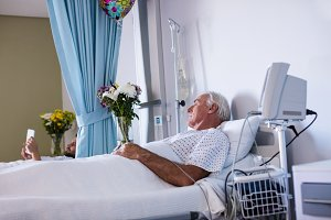 Male senior patient relaxing in the ward