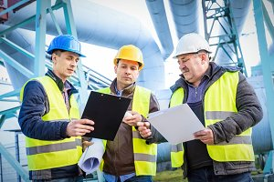 Engineers discussing maintenance of a petrochemical plant