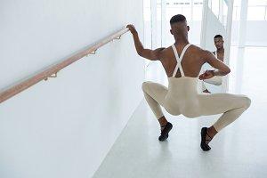 Ballerino practicing ballet dance in front of mirror