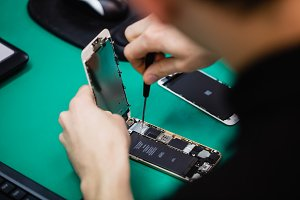 Man repairing mobile phone