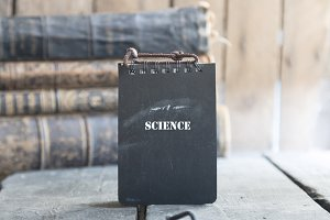 SCIENCE text and old books.