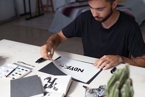 Calligraphy artist creates lettering