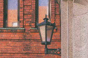 Street lamp on the red wall