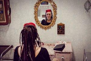 Female hairdresser in dreadlocks shop