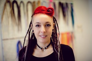 Female hairdresser in dreadlocks shop