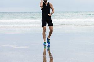 Athlete jogging on the beach