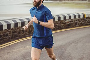 Athlete running on the road