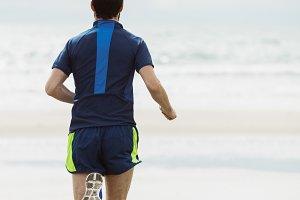 Athlete running on the beach