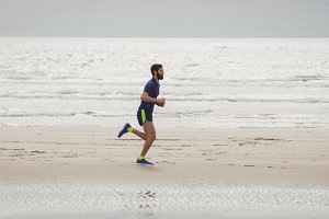 Athlete running along the beach