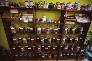 Various glass crockery and containers arranged on shelf