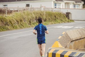 Man jogging on the open road