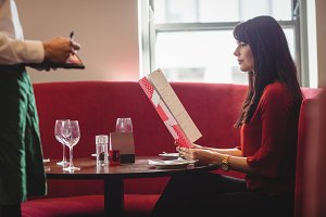 Waiter taking order from woman