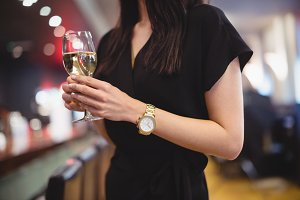 Woman holding wine glass in restaurant