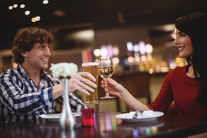 Couple toasting glasses of drinks