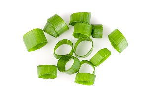 Chopped fresh green onions isolated on white background. Top view