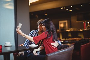 Couple taking a selfie using mobile phone
