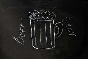 beer mug drawn with chalk on blackboard