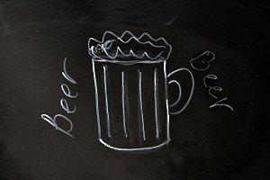 beer mug drawn with chalk on blackboard