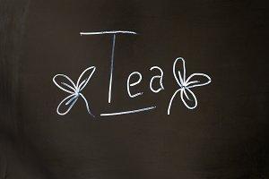 """The words """"Tea """" on a blackboard in chalk"""