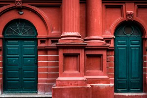 Green Doors with Red Frame