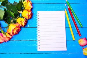 Blank notepad and pencils