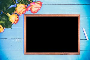 Empty black board and bouquet