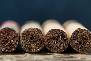 Close-up of Cuban cigars on brown marble. Macro shot.