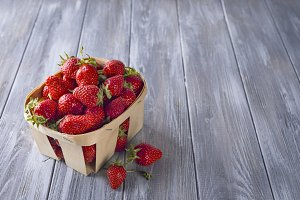 Fresh strawberries in a wooden crate