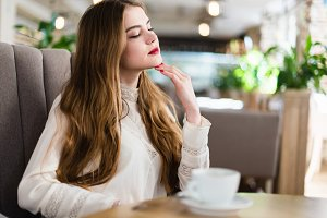 Beautiful girl in a cafe