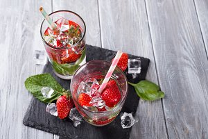 Glasses of lemonade with strawberries