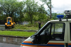 Hurricane in Moscow - fallen trees, torn out poles, wires, equipment, people, rescuers, police