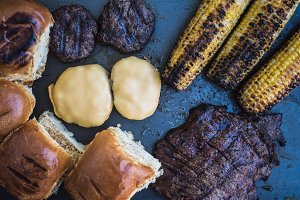 Grilled burgers, steak and corn