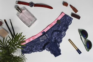 Shopping and fashion concept. Set of glamorous stylish sexy lace lingerie, woman accessories on wooden background